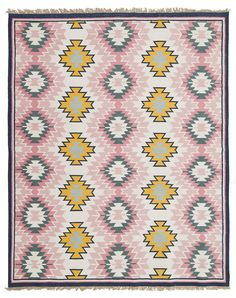 An L & G Signature Rug. Chevron zig zags in shades of pink and blue give this Aztec style rug a touch of sweet femininity.