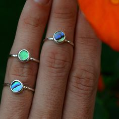 Tiny Abalone Shell set in sterling silver with hammered band. Abalone measures 6mm Looks cute alone or stacked with our Sea Glass and Shaka Rings! Made to order in your size.