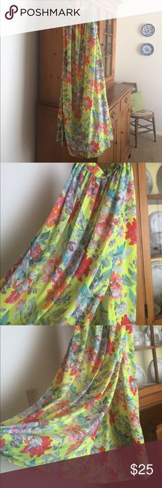 Bright Floral Sabo Skirt Maxi Gorgeous floral print maxi skirt. Semi-sheer with side slit. Elastic waist (I wear it high waisted). Worn twice. 100% polyester. I am 5'3 and it is pretty long...I wore high wedges and it was still long. If you are crafty, you could make a shorter skirt and use the extra fabric for something else! XS in Australian sizing so if you aren't pretty petite, it probably won't fit. Sabo Skirt Skirts Maxi