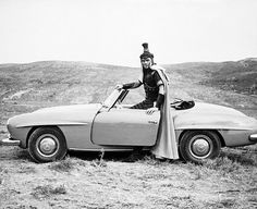 actor yul brynner in costume for the movie 'solomon and sheba' takes a break and goes for a spin in his mercedes-benz 190 sl.