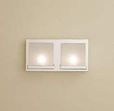 "Avia Double Sconce 12¾""W x 4""D x 6½""H Steel frame with frosted glass shade Hand-polished, richly plated finishes Uses two 20W frosted halogen bulbs (included)"