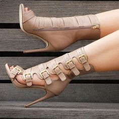 Lola by Nelly Bernal Heels - into the buckles and boot look