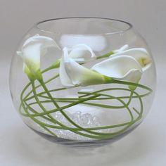 Calla lily in fish bowl vase