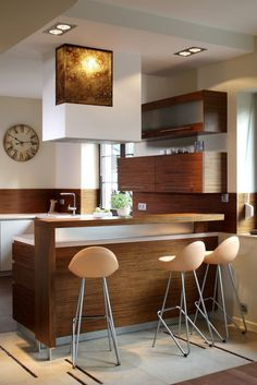 A small kitchen with a dark woodwork, smoked glass, and an eat-in counter. What do you think of that beautiful glass?