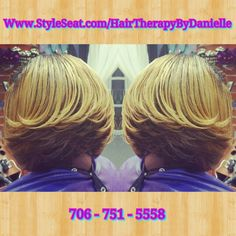 Hair cut into a feathered bob and colored
