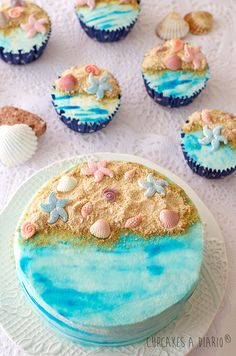 Suddenly You're at the Beach Cookie Crumb Sand, Candy Seashells, Food Color Swirls Waves or Food Color Spray, All on a Smoothed Buttercream Base