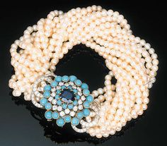 A Cultured Pearl, Sapphire, Turquoise and Diamond Bracelet by Cartier  The detachable brooch clasp of openwork design, centred with a cushion-cut sapphire within an alternating cabochon turquoise and circular-cut diamond surround with diamond-set scrolled clasps to the fifteen row cultured pearl torsade, circa 1960, with French assay and maker's mark, 23.0 cm long Signed Cartier, Paris, No. 010 689