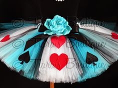 Tutu - Alice of Hearts - A Tiaras Boutique Original Design - Custom Sewn Tutu - Up to 12 Long - girls size 6 to 8 or up to a 24 waist This unique tutu is created with 3 different colors of tulle in a striped pattern, divided by thin stripes of black tulle. This unique tutu is embellished