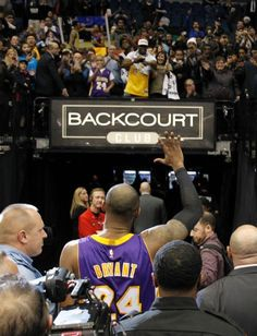The Black Mamba has left the building. The Lakers Kobe Bryant waves to the  crowd 891b4d452