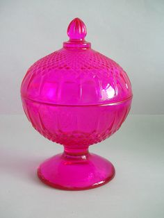 Pedestal candy dish with lid. This is what I'm looking for, but not in hot pink.