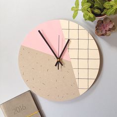 Pastel pink, grey and white wall clock with modern geometric Memphis inspired dot dash and grid pattern.  This clock will add a subtle dash of on-trend colour and print to your walls, and makes for a brilliant housewarming or wedding gift. Plus, the quiet sweep mechanism is ideal for light sleepers. ------------------------  The details:  Designed and created in my home studio by the sea in Brighton, this item is made from a 30cm plywood clock face, which is then hand-painted and coasted…