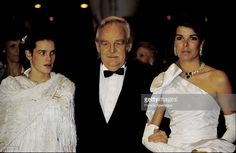 Prince Rainier of Monaco at the annual Bal de la Rose (Rose Ball) in Monaco with his daughters. Left Princess Stephanie. Right Princess Caroline. 5 March 1983.,