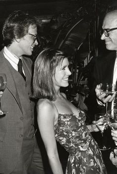 geek culture Carrie Fisher and Peter Weller at a Giorgio Armani Fashion Show - September 1980 Debbie Reynolds Carrie Fisher, Carrie Frances Fisher, Carrie Fisher Young, Seinfeld, Peter Weller, Star Wars Cast, Princesa Leia, Han And Leia, Hollywood
