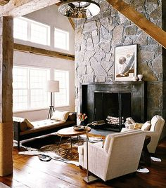 Modern Rustic barn - This place has a mixture of very clean lines and soft furniture. I really like how well it works together.