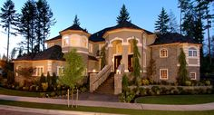 The classic facade of the 4,684 Sq. Ft. Kaslo House Plan is highlighted by a sweeping stairway leading to the graceful columns and arches of its grand octagonal entry. To see the actual floor plans for this home, click here: http://www.thehousedesigners.com/plan/kaslo-3229/