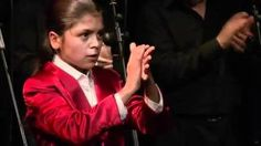recording of a live show at 'CASA PATAS' (flamenco club in Madrid). The dancer; 'EL CARPETA', a young member of the Flamenco gypsy Farruco family.