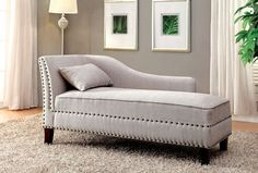 "Still water collection beige linen like fabric padded chaise lounge with nail head trim accents . Measures 61"" x 25"" x 37 1/2"" H . Some assembly…"