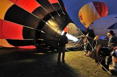Balloon crew working together to inflate hot air balloon.