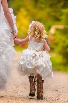 The bride and her daughter walking towards the wedding ceremony - SO cute!  We loved capturing this mountain wedding photography up in Barriere, British Columbia Canada!  http://tailoredfitphotography.com/wedding-photography/kamloops-barriere-wedding-johnson-lake-resort/