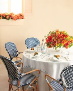 Bistro-style tables covered with custom-embroidered linen create the feel of a French cafe
