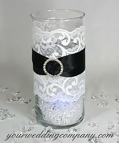 Lace is the perfect accent for rustic or vintage-themed weddings.  Use it on candles, table runners, cakes, favors, vases, jars, invitations, bags, gifts and bouquet handles.This is a flat, nylon-blend, double-scalloped lace trim with a scroll pattern.