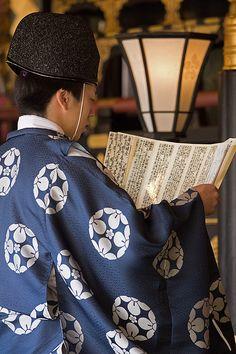 Shinto Priest Reading Prayer by Jason Racey, via Flickr