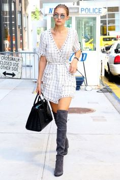 Gigi Hadid's best outfits: Wrap dress and knee high boots.