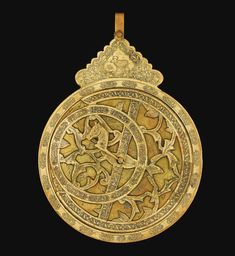 A DECORATIVE BRASS ASTROLABE, QAJAR, PERSIA, 19TH/20TH CENTURY