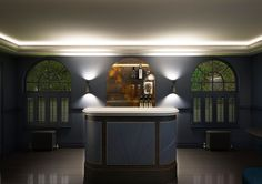 Current Project. Art Deco inspired Bar for private residence. Stereo Interiors Sacarmento Wall covering & Fired Earth Carbon Blue Walls. Antique Bronze Metal Detailing.  Pewter Bar Top and Whistler Leather Bar Front