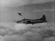 A German Me 163 Komet flies past an American B-17 Flying Fortress sometime during the Second World War. (Photo)