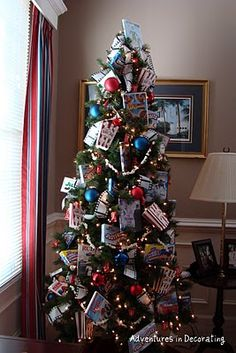 Media Room Tree, decorated with movies, popcorn, and candy boxes. LOVE!