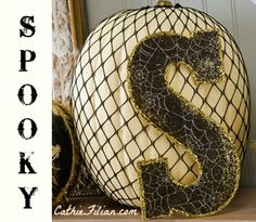 Monogram Pumpkin made with Mod Podge, Fishnet Tights and Glitter