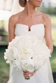 Brides.com: . For their destination wedding in Palm Beach, Florida, Caroline and Rascoe planned an elegant reception with plenty of classic details. The bride's bouquet didn't deviate in style. Xquisite Events created an ultra-classic all-white bouquet of peonies for Caroline to carry.