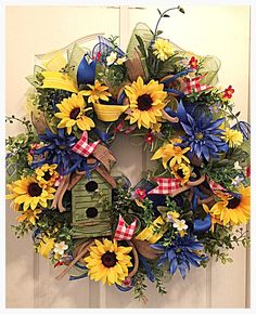 Wow, you will really enjoy your summer this year when you hang up your beautiful blue sunflower birdhouse deco mesh wreath. It is made on a wired Wreath form with high quality Moss ,blue and yellow deco mesh. Nestled in the middle of the wreath is a Moss green wooden birdhouse.
