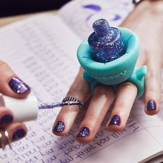 The design of this wearable nail polish holder makes painting your nails easier