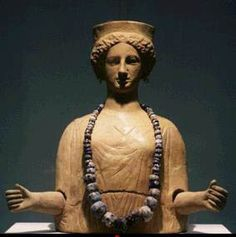 Goddess Tanit: Tanit was the Carthaginian and Phoenician Goddess of the moon. Here is Tanit in Greek style-- except for the North African beads. She wears a classical peplos, but her arms are outstretched in the archaic gesture of Artemis Ephesia. Terracotta from the island of Ibiza, circa 400 BCE.