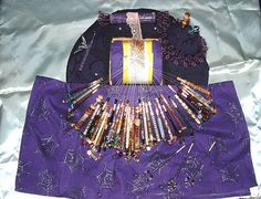 bobbin lace pillow, it looks as though the bobbins are from different batches. I like repurposing things;)
