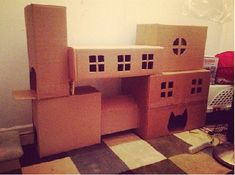 Awesome cat houses... wait for it.... from cardboard boxes!