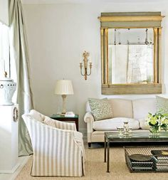A palette of white, cream, and gray is enlivened by pops of gold,