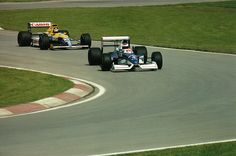 Jean Alesi in a Tyrrell-Ford and Thierry Boutsen in a Williams-Renault at the 1990 Canadian Grand Prix.