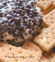 Chocolate Chip Cheese Ball--for a wedding reception. 2 - 8oz cream cheese  1/4 cup butter  1/2 tsp vanilla  1 1/2 c powdered sugar  4 tbsp brown sugar  1 1/2 c mini chocolate chips Combine. Roll into a ball. Chill. Roll in more chocolate chips or in ground nuts. Serve with graham crackers.