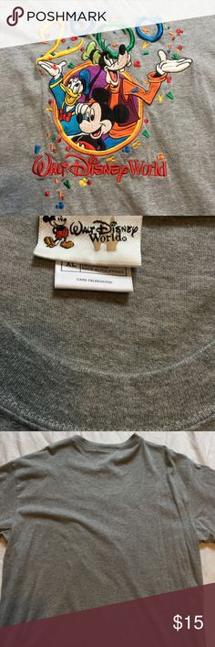 Walt Disney world millennial t-shirt Walt Disney World  T-shirt  adult size extra large  chest is 24 inches laid flat across  length is 31 inches  gray shirt with Mickey Mouse, Donald duck, and goofy  2000 millennial with Mickey confetti Shirts Tees - Short Sleeve