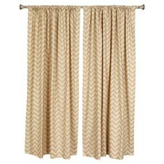 """Set of two curtain panels with a rod pocket design and chevron motif. Made in the USA.  Product: Set of 2 curtain panelsConstruction Material: CottonColor: Khaki and naturalFeatures:  2"""" Rod pocket3"""" HemMade in the USA Cleaning and Care: Spot clean"""