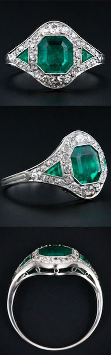 Art Deco Emerald and Diamond Ring, The deep rich green crystalline, octagonal step-cut emerald measures 1.10 cts, but appears much larger due to its slightly 'spready' cut. The emerald is flanked by a pair of small triangular emeralds and all three are outlined by a half carat of glittering European cut and single-cut diamonds set in platinum. circa 1920.