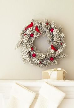 Snowy wreath: Turn a store-bought pinecone wreath into a showstopping mantel display. Spray-paint the wreath gray, then add spray snow and silver glitter. Glue on cardinals and shiny red ornaments for accent color. Simple Christmas, Christmas Holidays, Xmas, Christmas Mantels, Christmas Decorations, Seasonal Decor, Holiday Decor, Family Holiday, Holiday Ideas