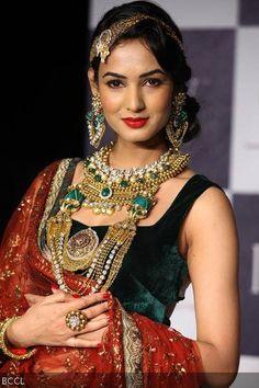 Sonal Chauhan walks the ramp to showcase jewellery creations by designer group Dipti Amisha during the third season of India International Jewellery Week (IIJW) in Mumbai on August 20, 2012.