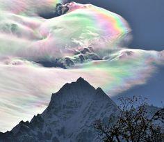 Iridescent Clouds over Thamserku  Image Credit & Copyright: Oleg Bartunov
