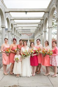 Coral bridesmaids in assorted dresses with matching bouquets. #bridesmaids #coral #weddingchicks Captured By: Rodeo & Co Photography ---> http://www.weddingchicks.com/2014/04/28/reveal-your-babys-gender-with-this-cute-wedding-idea/