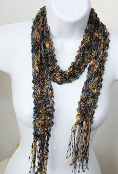 Scarf made of camels, browns and blue colored trellis yarn can be worn during the day with jeans and even into the evening with more formal attire.
