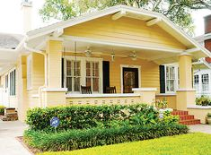 A covered front porch and detailed landscaping provide curb appeal.